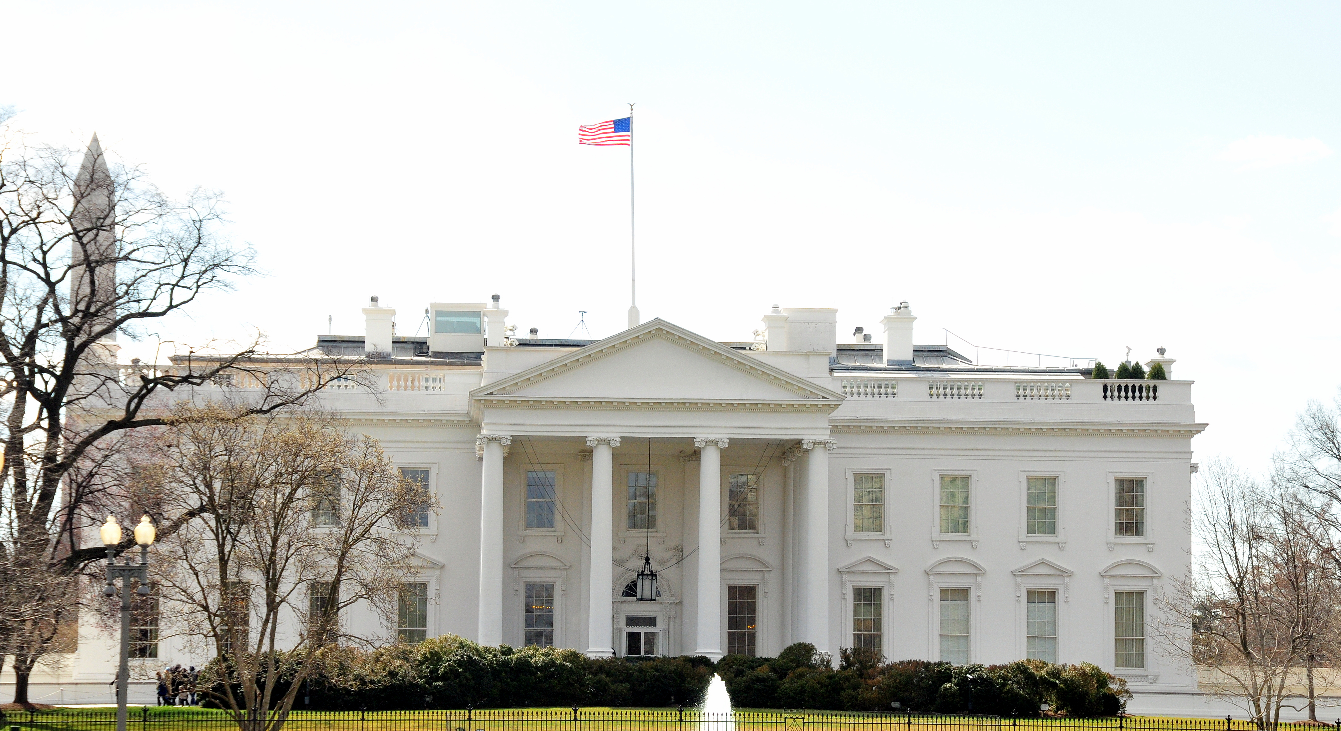 Image of the White House with the American flag on top.